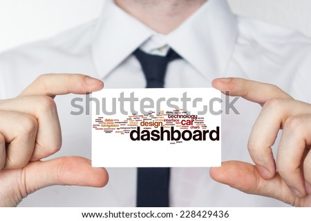 Artist. Businessman in white shirt with a black tie showing or holding business card. - stock photo