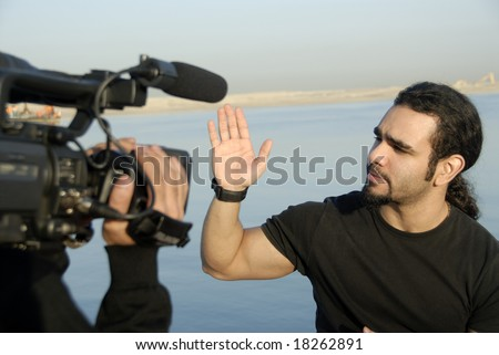 Artist & Cameraman Filming Video Footage In Daylight - stock photo