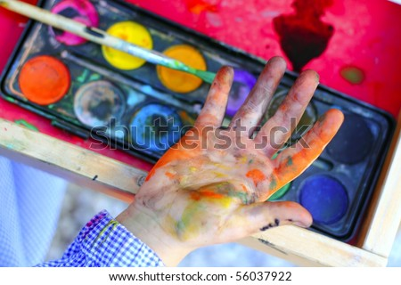 artist children painting watercolor brush self dirty hands - stock photo
