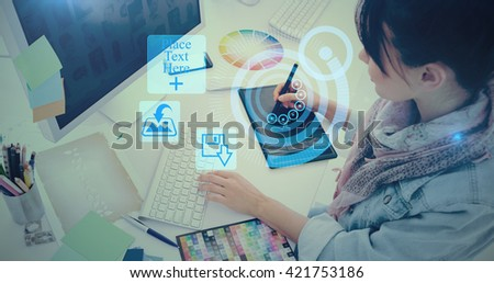 Artist drawing something on graphic tablet at office against interface - stock photo