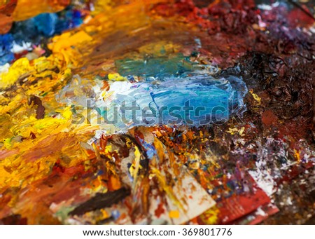 artist draws a picture color palette, brushes, artist's place, a creative mess