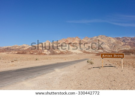 Artist Drive road signpost leading to the Black Mountains, Death Valley, California - stock photo