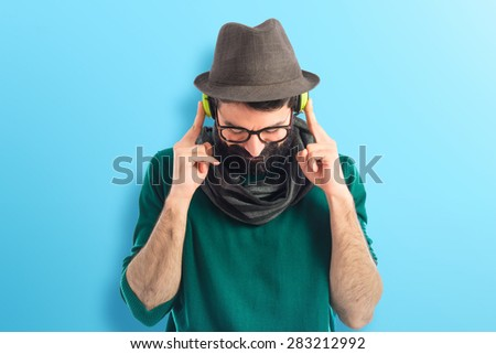 Artist listening music over colorful background - stock photo