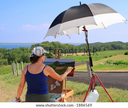 Artist makes time to pursue her craft - stock photo