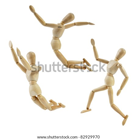 Artist Mannequin in jump poses, isolated wood human model