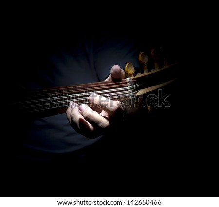 Artist playing Egyptian oud - stock photo