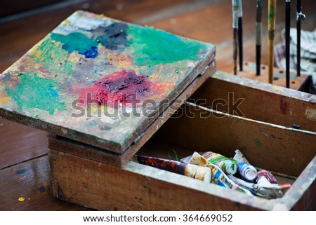 Artist's old wooden rustic box, retro style palette - stock photo