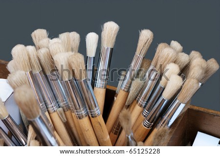 Artist's paintbrushes, closeup, isolated on grey.