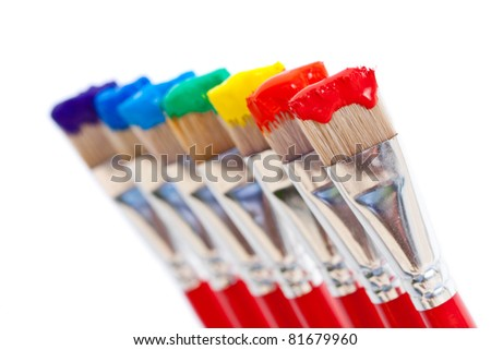 Artist's paintbrushes holding all seven colors of the rainbow - red, orange, yellow, green, blue, indigo and violet