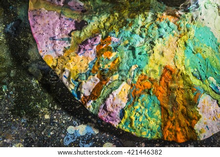 artist's palette splashed with different colors