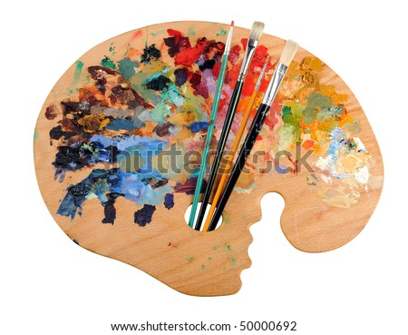 Artist's palette with brushes isolated over white background - stock photo