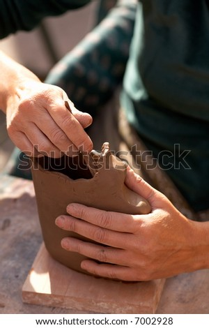 artist shaping a vase - stock photo