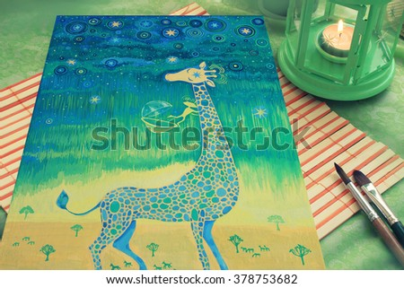 Artist table with painting picture lamp and brushes. - stock photo