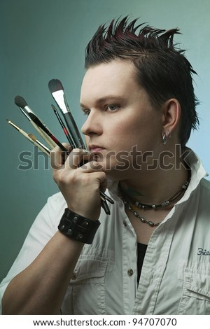Artist with brushes. posing - stock photo