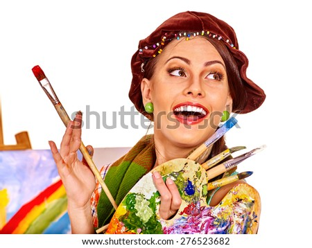 Artist woman in hat at work. Isolated on background. - stock photo