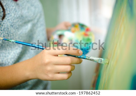 Artist working on a painting - stock photo