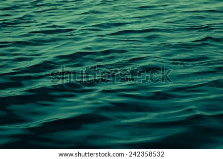 artistic adaptation of the surface of a body of water  - stock photo