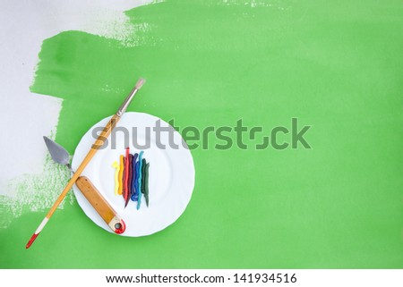 Artistic background with oil paint and painting instruments - stock photo