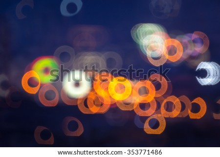 Artistic blur and donut bokeh of downtown Kuala Lumpur, Malaysia. The donut bokeh effects come from old reflex lens which currently not in production.   - stock photo