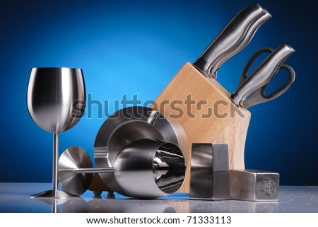 artistic composition of metal kitchen accessories - stock photo
