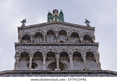 Artistic details on a facade of Lucca cathedral, Tuscany, Italy - stock photo