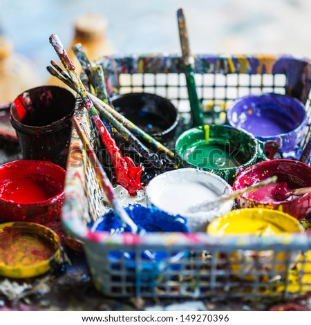 Artistic equipment ; paint, brushes , palette and knives - stock photo