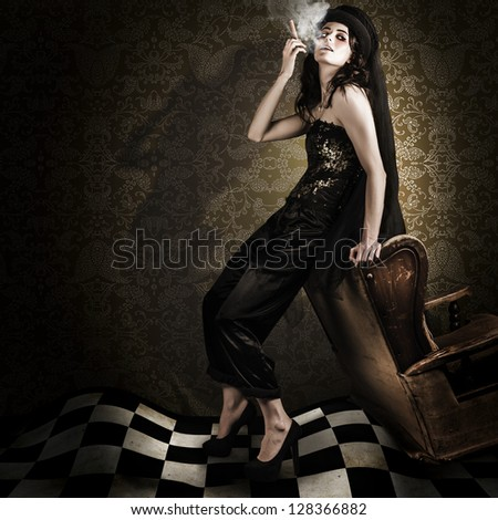 Artistic Fashion Photo Of Beautiful Avant-garde Woman Smoking Cigar In A Dim Vintage Interior While Portraying The Twisted And Edgy Look Of Grunge Fashion - stock photo