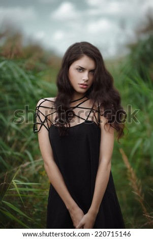 Artistic fashion portrait of young gorgeous brunette outdoors. Shallow depth of field - stock photo