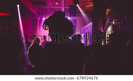 Artistic Female Silhouette with Purple Lighting Background