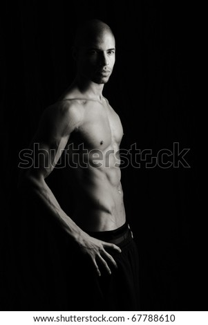 Artistic Fitness on a black background, Low key - stock photo
