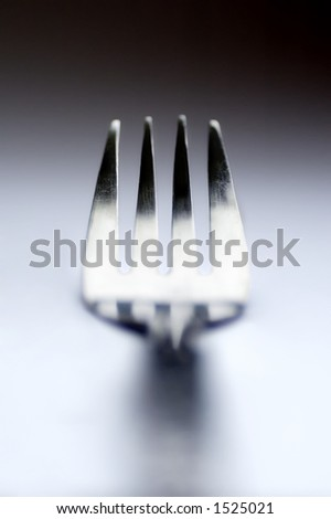 artistic fork on a table - stock photo
