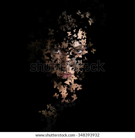 Artistic image of woman on black with butterfles - stock photo