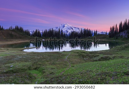 Artistic landscape of a lake and mountain at sunrise