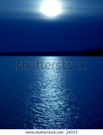 Artistic ocean scene of a sunset, although could be a moonset. - stock photo