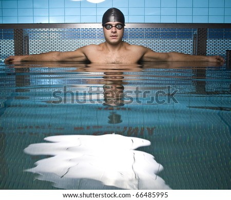 Artistic portrait of athlete swimmer in water - stock photo