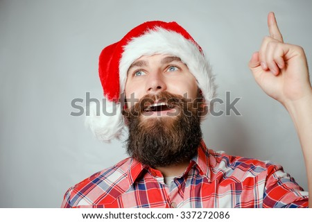 Artistic portrait of gray haired santa claus santa, white, hat, red - stock photo