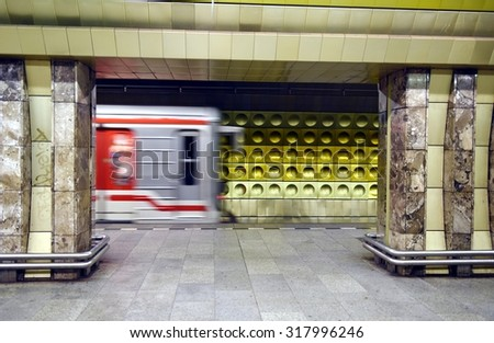 Artistic public subway train station in Prague with  train in motion blurred effect. New generation of colored and technological underground metro station without people. - stock photo