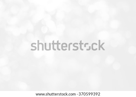 Artistic style - Defocused abstract white and gray bokeh lights background with blurring lights for your design - stock photo