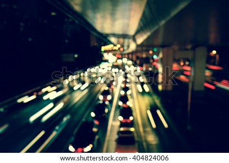 Artistic style - Vintage style, Defocused urban abstract texture bokeh city lights & traffic jams in the background with blurring lights. - stock photo
