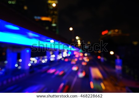 Artistic style - Vintage style, Defocused urban abstract texture bokeh city lights & traffic jams in the background with blurring lights.
