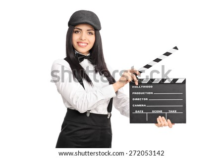 Artistic young female director holding a movie clapper board and looking at the camera isolated on white background - stock photo