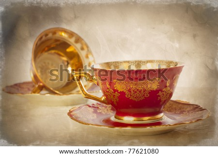 Artistically, textured antique china cups and saucers - stock photo
