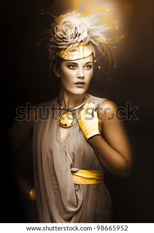 Artistically toned image of a woman in a vintage high fashion outfit with selectively coloured fascinator hat and matching accesories - stock photo