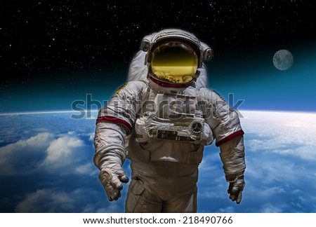 Artists image of an Astronaut in space over the planet earth. - stock photo