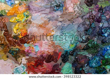 artists oil paints on wooden palette. macro artist's palette, texture mixed oil paints in different colors and saturation. art palette background - stock photo