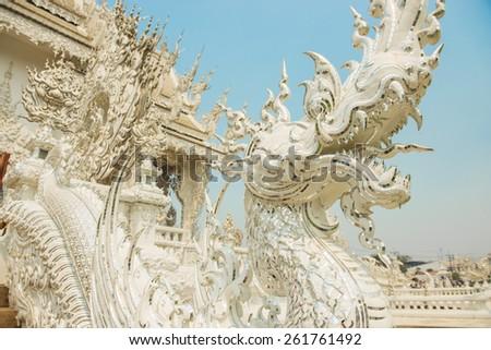 Arts of Buddhism - White King of Naga statue at Rongkhun Temple Chiangrai, Thailand. - stock photo