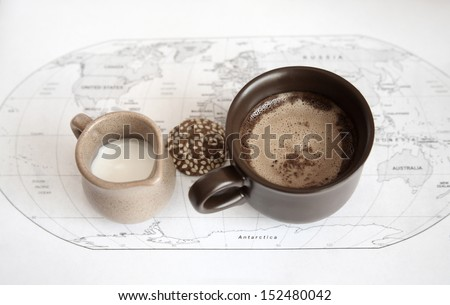 artwork  in grunge style,  two cups of coffee, milk jug, cookie,  world political map - stock photo
