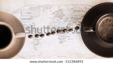 artwork  in retro style,  two cups of coffee and wold political map - stock photo