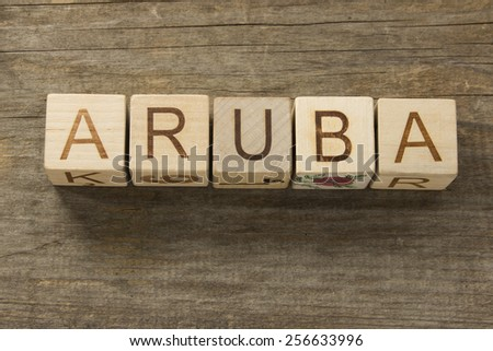 Aruba on a wooden background - stock photo