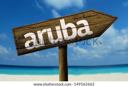 Aruba wooden sign with a beach on background  - stock photo